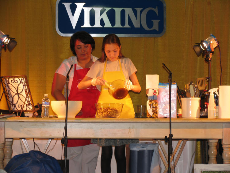 Mallory with Danielle Edmonds on stage at Taste of Home Cooking School in Kalispell, Montana