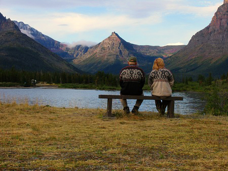 Couple sitting on bench in Two Medicine, Glacier National Park