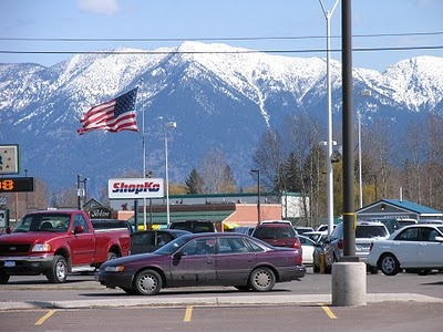An American flag stands out against the view of the beautiful snow capped peaks of the Swan Range from the ShopKo parking lot.