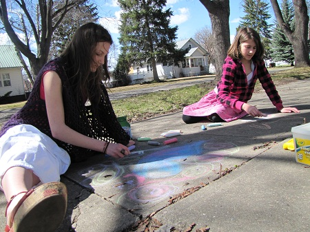 M and E creating sidewalk art.