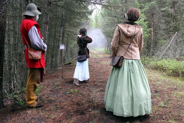 Taking a shot with the muzzleloader rifle while R. and Eileen watch