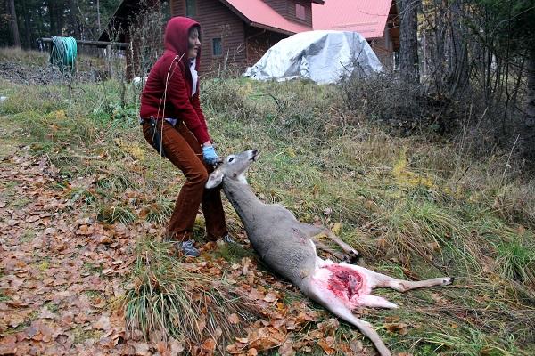 Hauling deer up the hill.RMKK