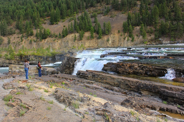 girls on rocks at Kootenai Falls